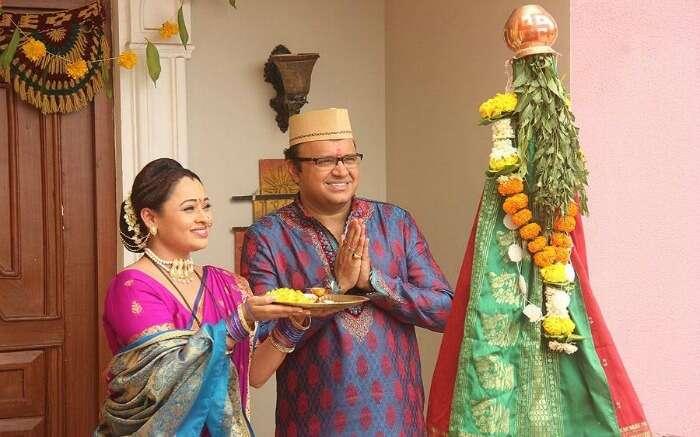 a couple worshipping during Gudi Padwa