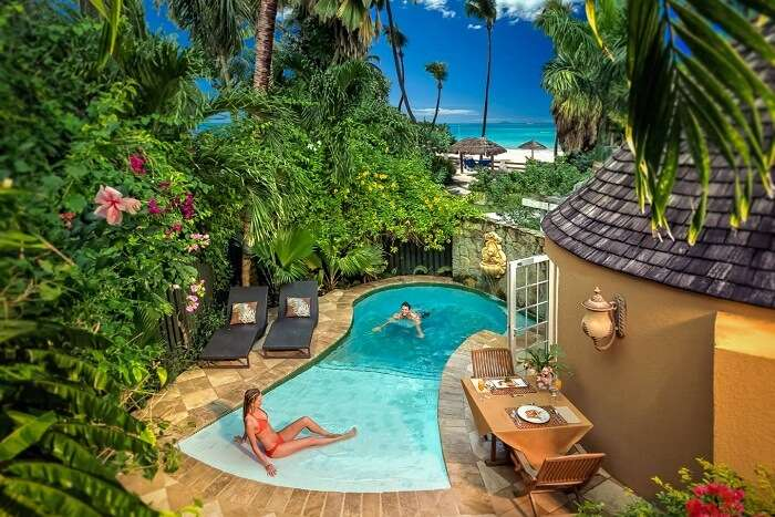A couple relaxing in a private pool at Sandals Resort in the popular Caribbean honeymoon destination of Antigua