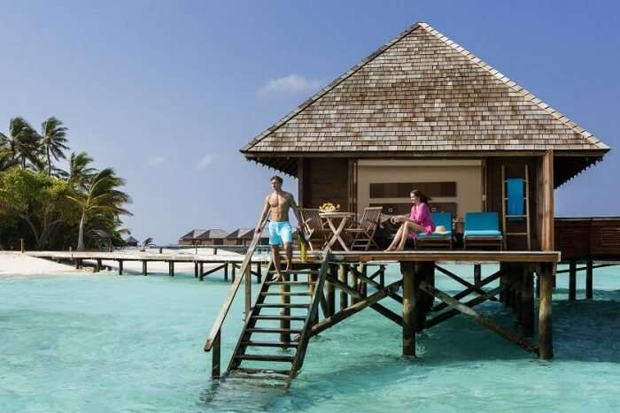 A couple staying at an overwater villa at the Veligandu Island Resort in Maldives