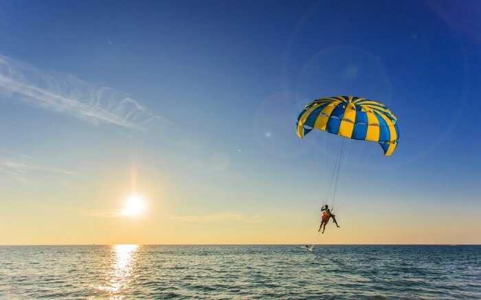 parasailing over an ocean