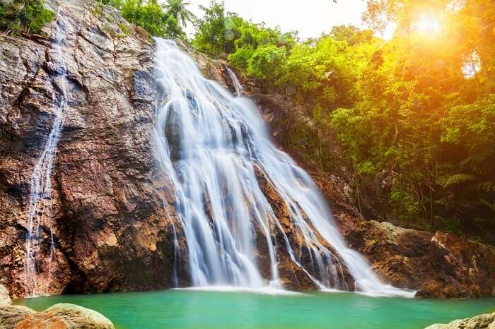 A sunset shot of the Na Muang waterfall in Koh Samui