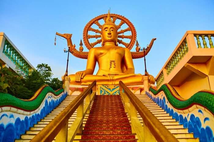 Golden Statue Of Buddha With Dragon Staircase In Wat Phra Yai or the Big Buddha Temple in Koh Samui