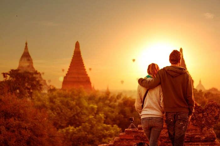 Young couple enjoying the sunset view at Bagan in Myanmar