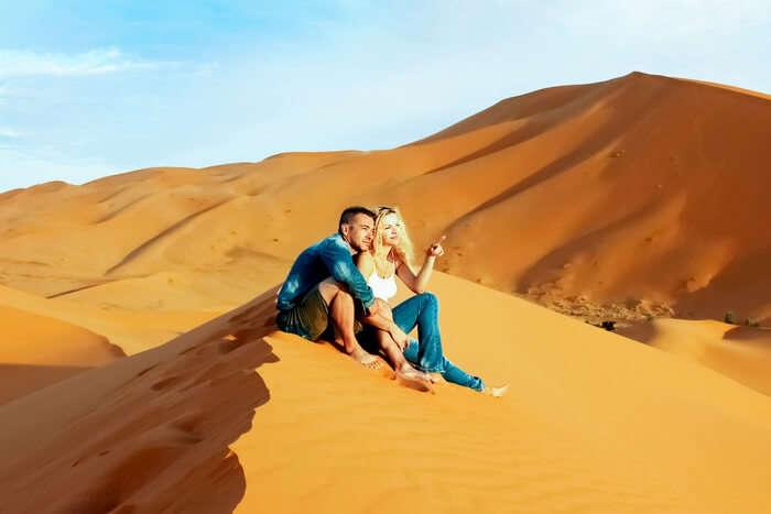 Loving couple in the Sahara Desert of Morocco