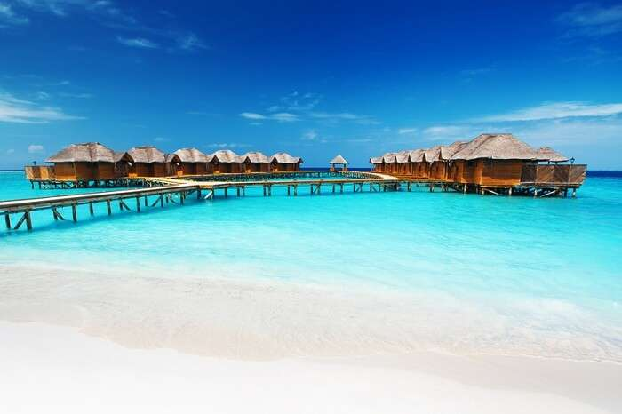 The overwater bungalows at the Fihalhohi Island Resort in Maldives