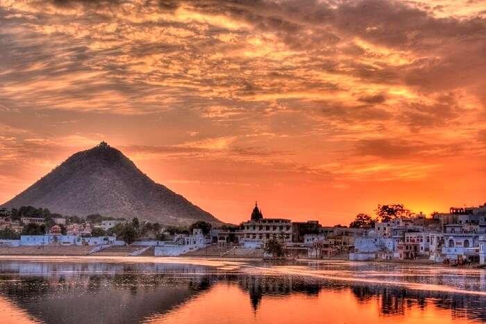 The orange sunset sky in the city of Pushkar
