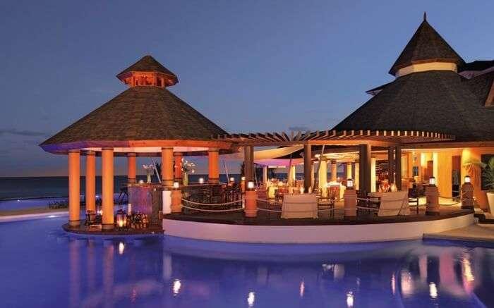 A hutlike resort in Jamaica at night