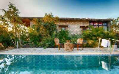 A pool by one of the cottages at Aryan Eco Homestay in Gujarat