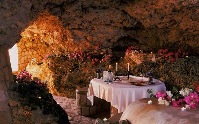A romantic dinner table in a resort built inside a cave in Jamaica