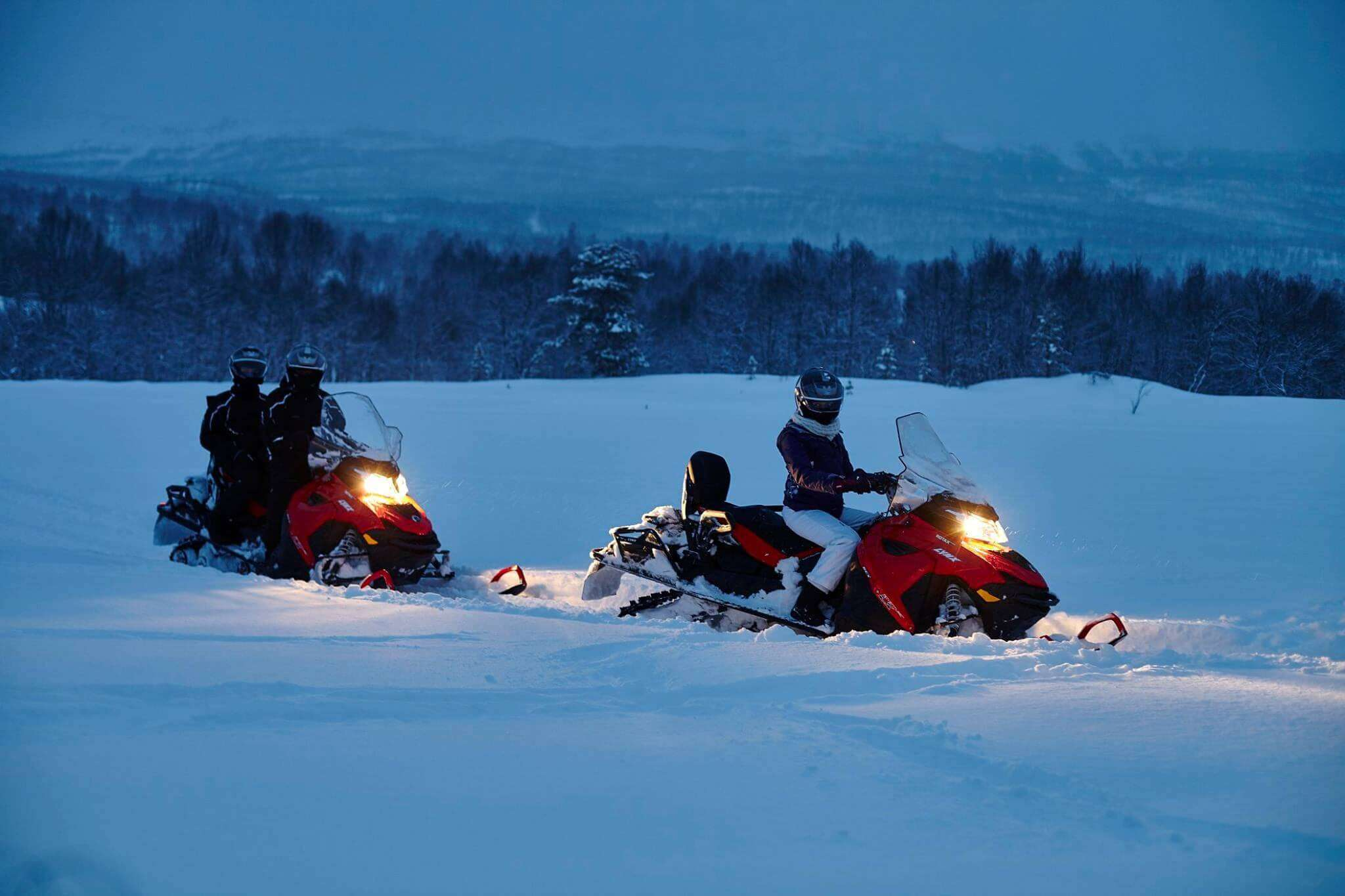 snowmobiles in snow covered Norway