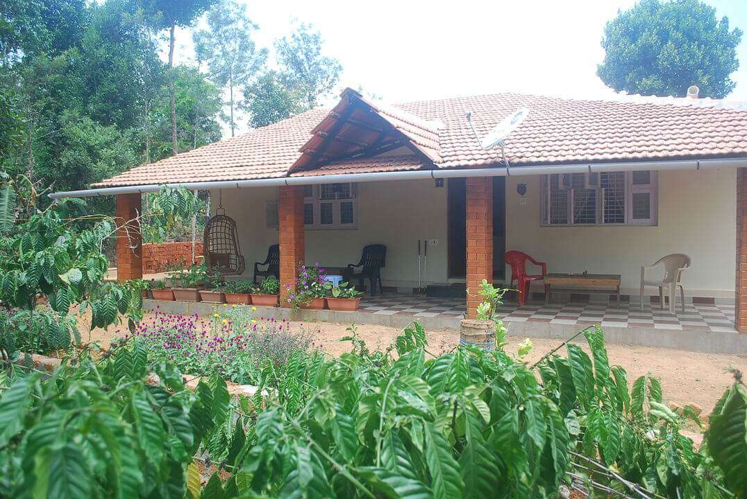 A Kannada style home with a porch