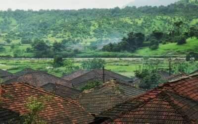 Roofs of houses in Purushwadi overlooking the green landscape