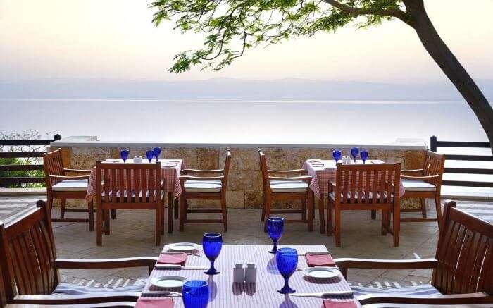 a romantic terrace restaurant with sea views