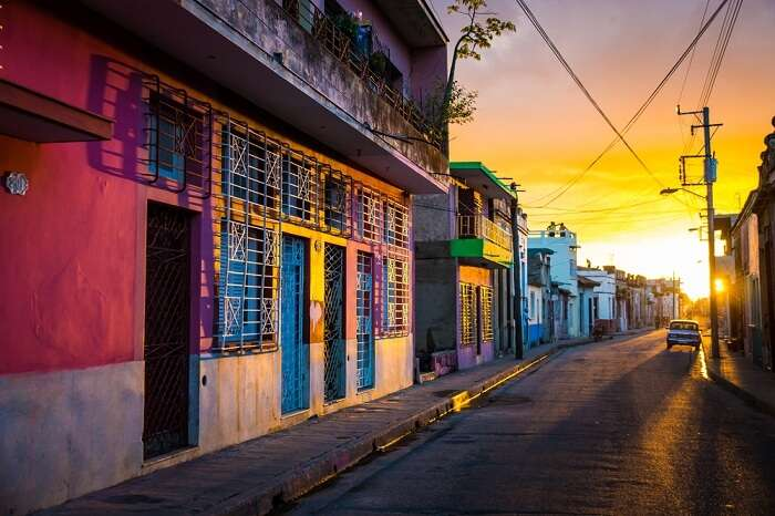The warm sunset light shines on the empty streets of the world heritage city centre in the Cuban city of Camaguey island in Caribbean