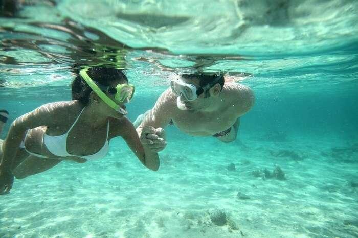 Couple snorkeling in Caribbean waters