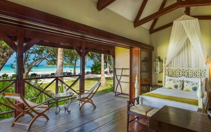 A beautiful room with two wooden chair overlooking the sea