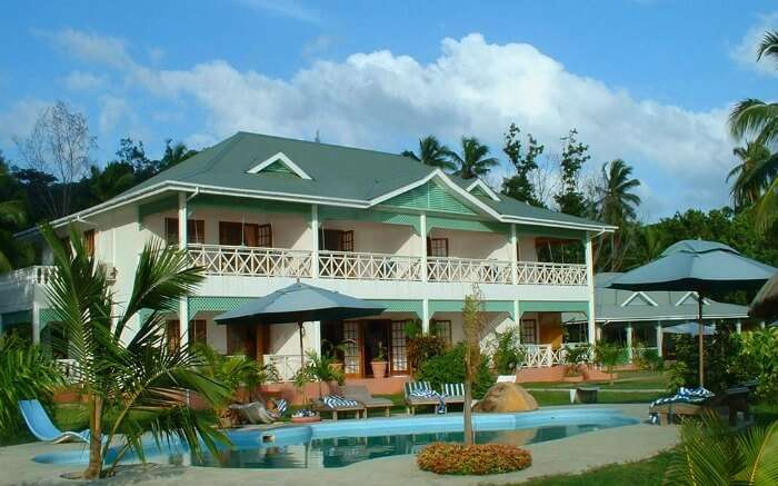 A colonial style hotel with an outdoor pool