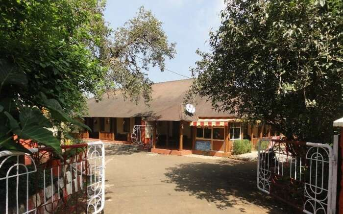 A cottage like hotel surrounded by trees in Mahabaleshwar