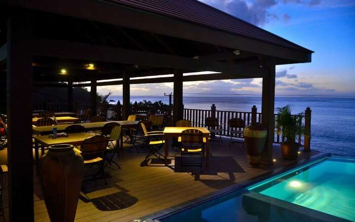 A gorgeous restaurant area with an infinity pool