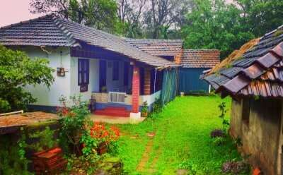 a beautiful old homestay with a small lawn