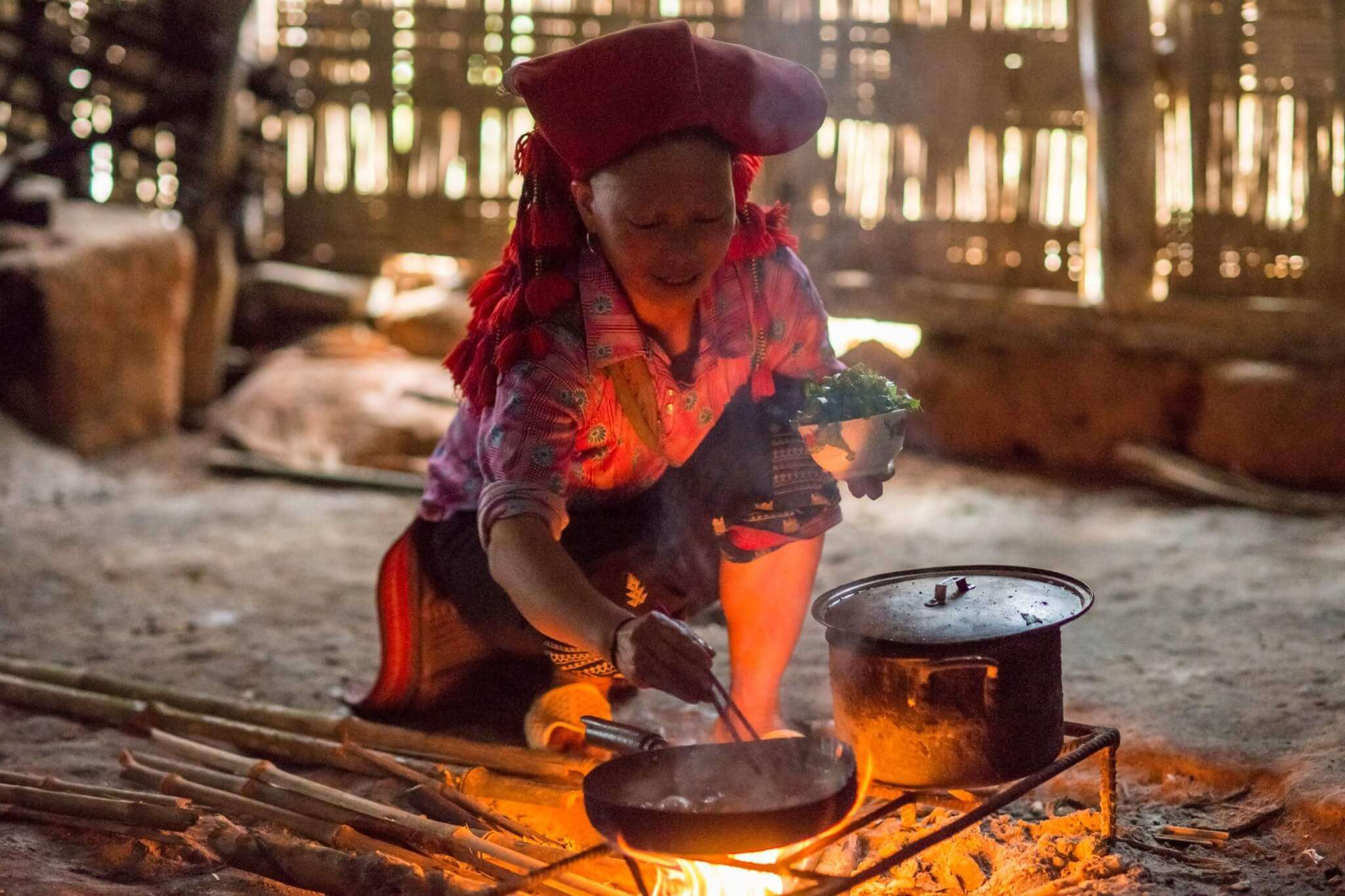a homestay host lady cooking food