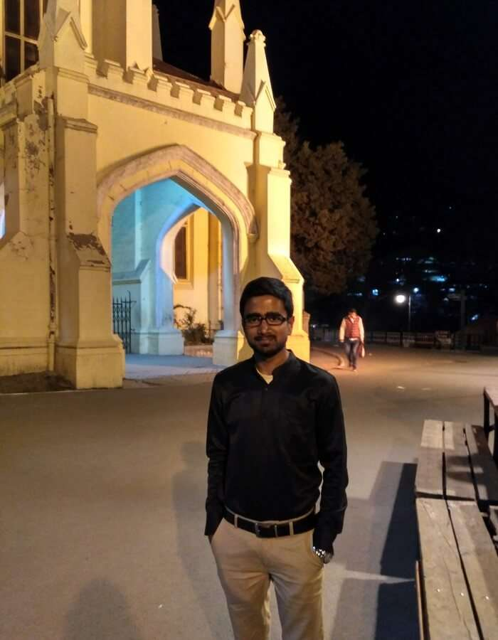 shish standing near christ church in shimla, an important landmark of his historical trip to shimla