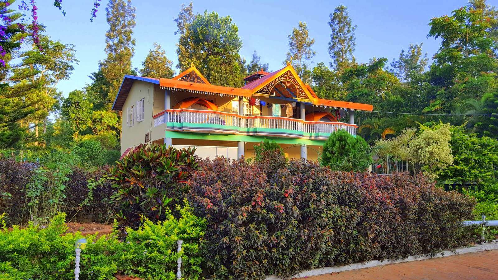 a colorful homestay surrounded by a garden