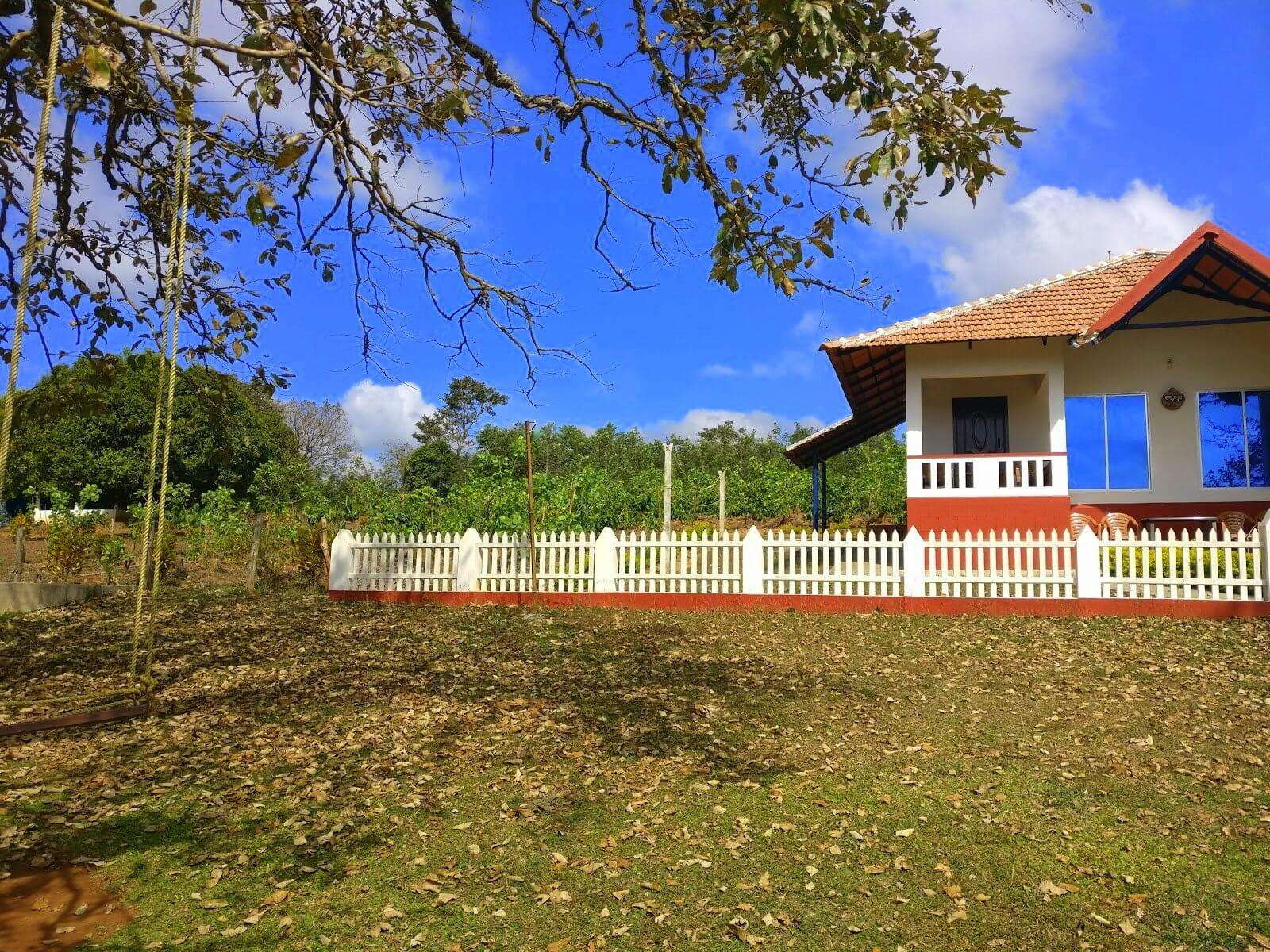 a beautiful home with fences and a big garden