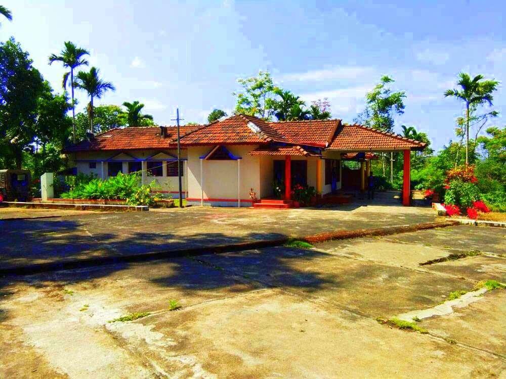 an old style Karnataka homestay with a grand veranda