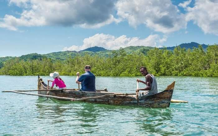Tourists taking a pirogue ride across a river in Madagascar