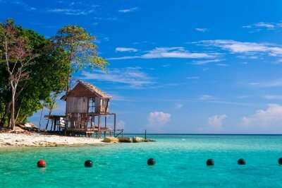 White beaches and emerald green sea waters await tourists at Sipadan Island that is an amazing diving site in Malaysia