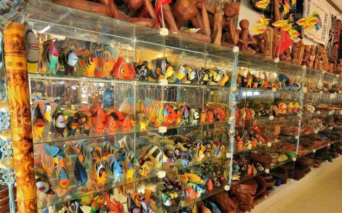 Colourful stuffed toys and wooden artifacts in a shop