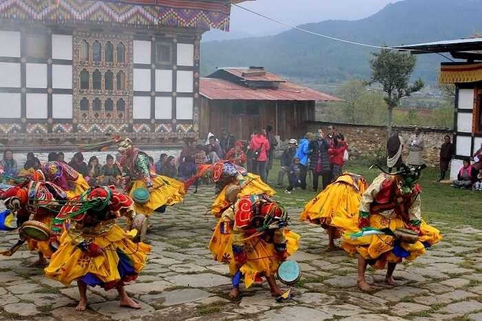 face mask dance in bhutan