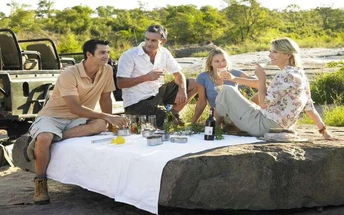 Four people enjoying picnic in the Kruger National Park region