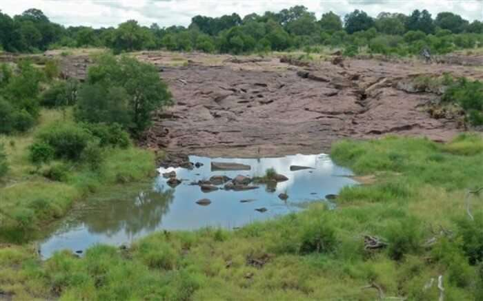 Red Rocks surrounded by dense forest in Nxanatseni Region in Kruger