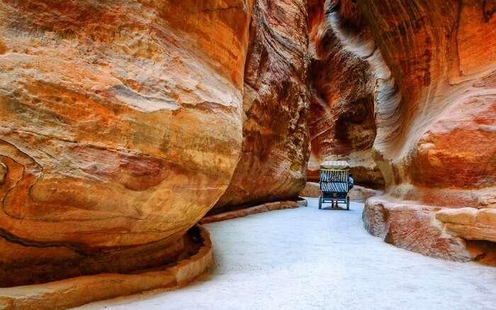 Siq narrow stone gallery in Petra