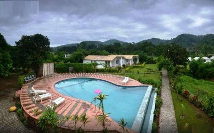 huge outdoor pool in the premises of a resort