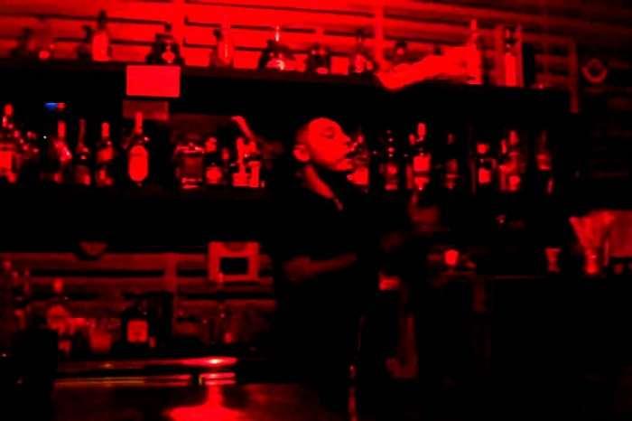 The bartender at Level 3 Bar in Mahe juggling drink bottles and glasses