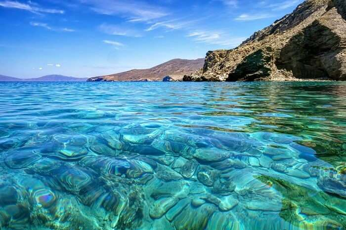 Clear transparent turquoise sea waters in Gyaros island