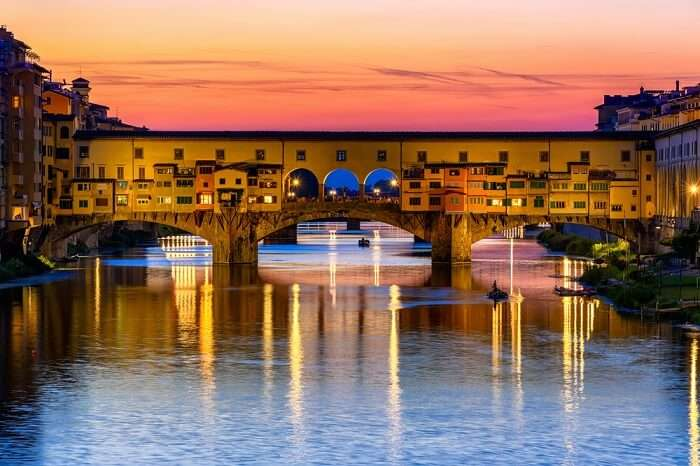 Sunset view of Ponte Vecchio over Arno River in Florence