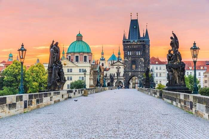 Charles Bridge and Old Town Tower at sunrise at Prague in Czech Republic