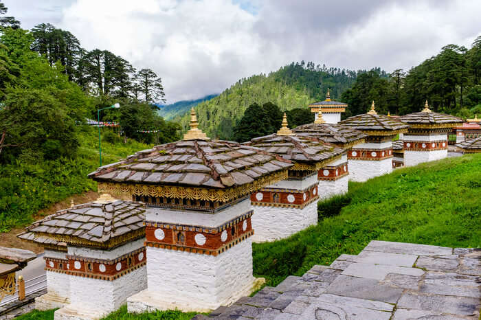 beautiful chortens on green hillside