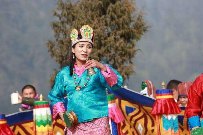 a Bhutanese woman performing dance