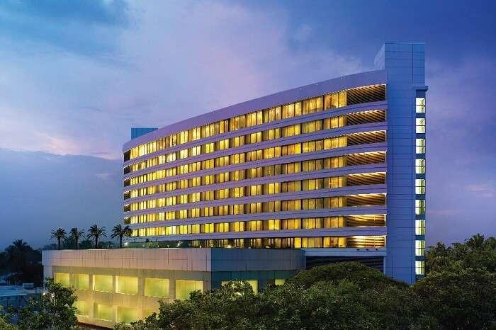 An evening shot of the main building of Vivanta by Taj hotel in Coimbatore