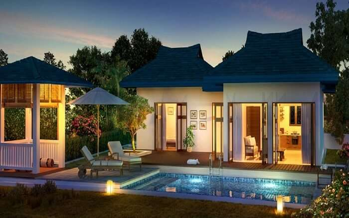 A view of Amaras Villa with a pool in Lonavala at sunset