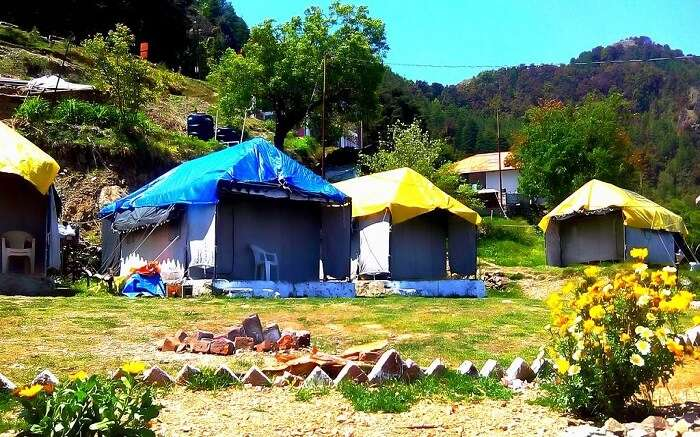 Tents with plastic roof in the mountains