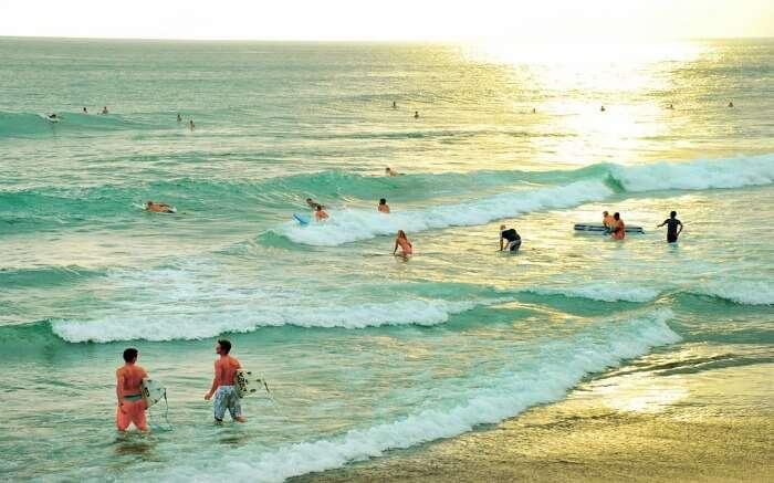 Tourists at Echo beach in Canggu in Bali
