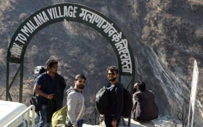Amit and his friends posing for a photo before starting the Malana Trek