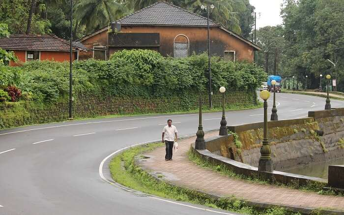 A man walking on clean roads in mountains