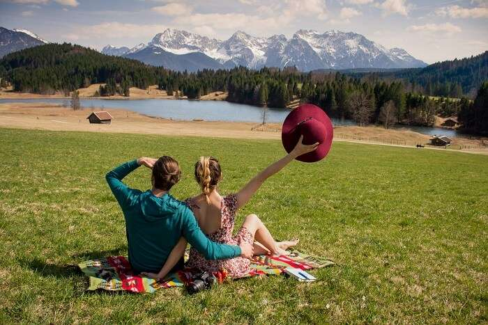 a couple enjoying a picnic on their honeymoon in Germany